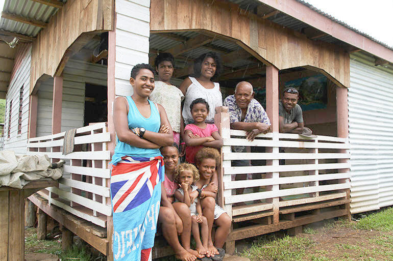 Home sweet home: Mosese Kakaramu and his broader family outside their new home.
