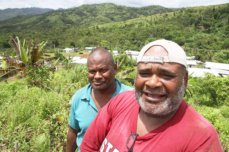 Village builder: carpenter Harold Koi and deacon-to-be Waisea Bogi.