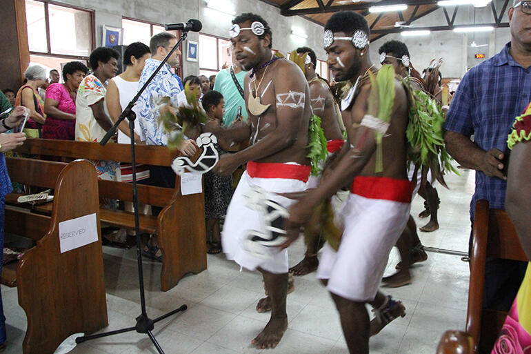 Melanesian clergy and students from PTC in traditional dress staged a dramatic Gospel procession.