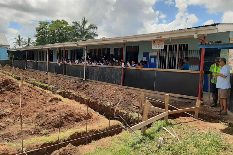 St Mary's Anglican School children look on from the sidelines as the first stage of their new classrooms take shape.