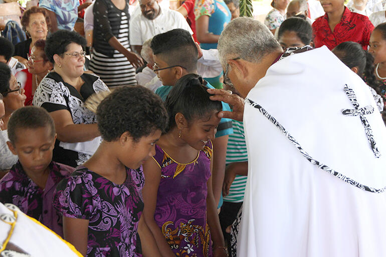 'Suffer not the little children to come unto me' - the bishops blessed dozens of children at the end of the service.