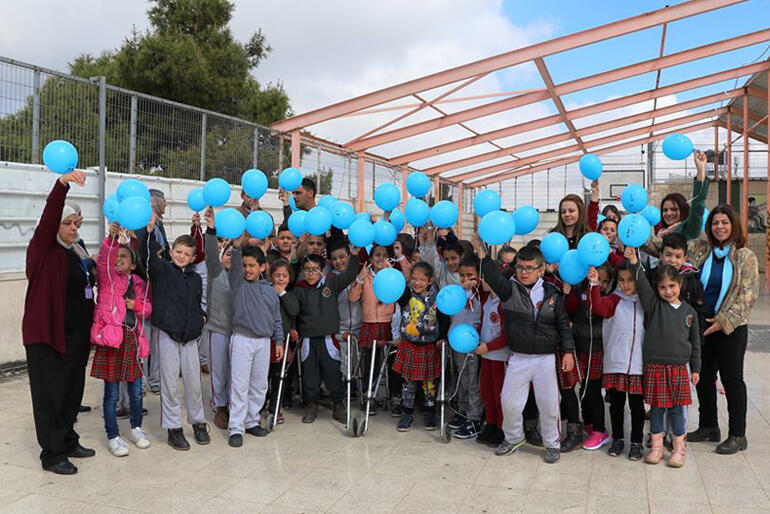 Staff and children line up for a picture at Jerusalem's Princess Basma Centre for children with disabilities.