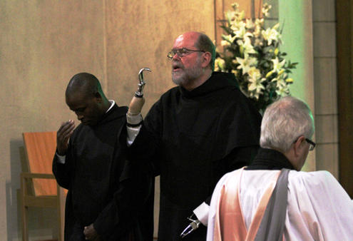 Fr Michael Lapsley pronounces the blessing at Holy Trinity Cathedral's midweek choral Evensong.