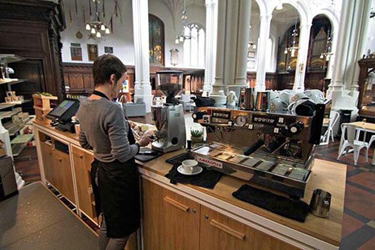 Barista gets ready at the Host café at St Mary Aldermary, London.The café is a fresh expression run by Moot, a new-monastic community.