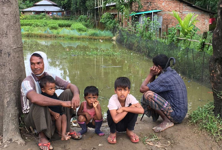 Rohingya men supervise children in one of the flood-stricken areas where aid agencies are working to provide food and shelter. Photo:Christian Aid.
